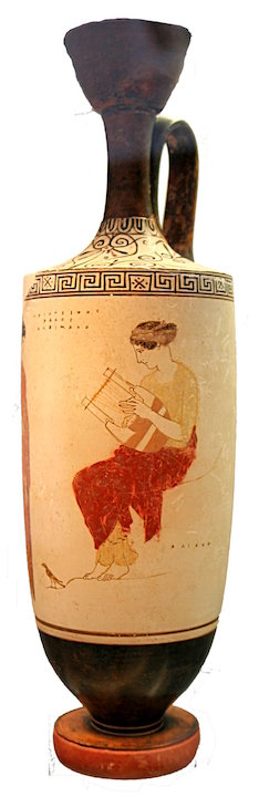 This is a photo of pottery painted with a scene of the muse seated wearing draped garments and playing a lyre.
