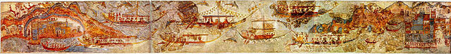 This is a color photograph of the fresco, which depicts eight large ships and three smaller vessels, all powered by men with oars. They appear to be traveling from one port to another.