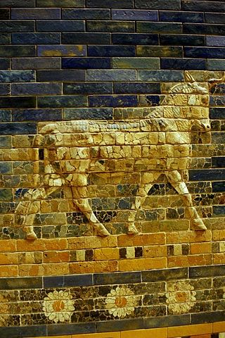Photo depicts a close-up of the bull figure on the Gate of Ishtar, constructed with glazed gold brick.