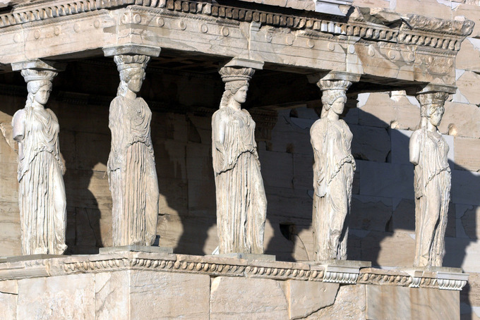 "This is a photo of the famous ""Porch of the Maidens"" with six draped female figures (caryatids) as supporting columns."