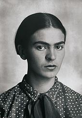 This is a black and white photo portrait of Frida Kahlo.