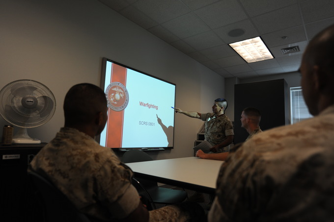 Sgt. Lorenzo Parco, a Sergeants Course Student, uses the new SMART board to show a PowerPoint slide during a class.