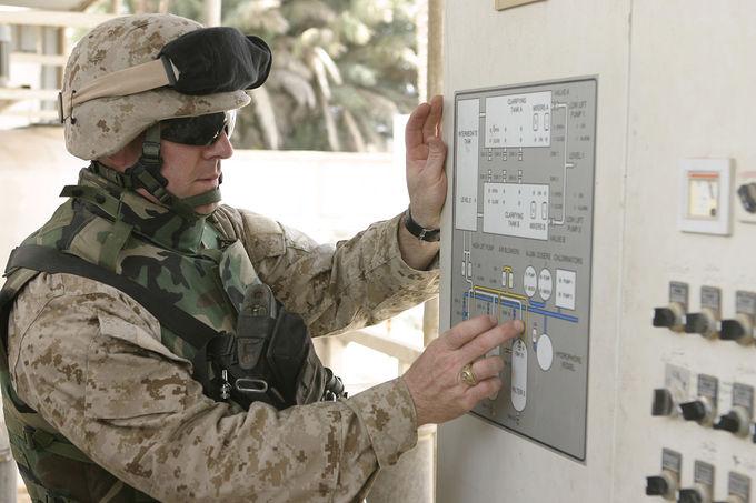 US Army executive officer examines a diagram at the Saqlawiyah water treatment facility April 28, 2005.