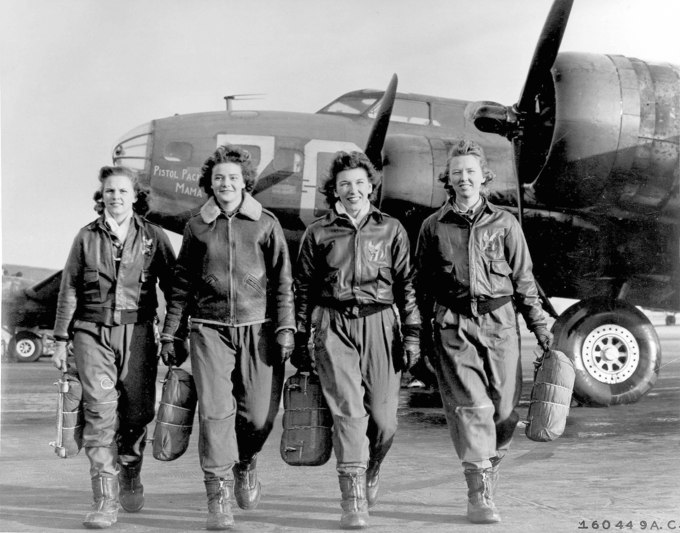 Four female pilots leaving their ship, Pistol Packin' Mama, at the four engine school at Lockbourne AAF, Ohio. The women were members of a group of Women Airforce Service Pilots (WASPS) who have been trained to ferry the B-17 Flying Fortresses.