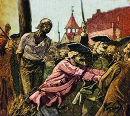 The illustration shows a black man tied to a stake with kindling aflame at his feet; white soldiers holding guns push back the crowd gathered to watch.