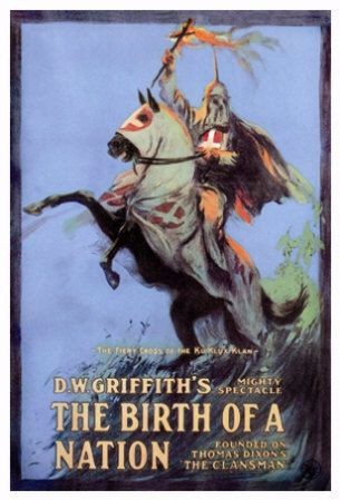 The movie shows a hooded KKK member riding a rearing horse and holding a fiery cross.