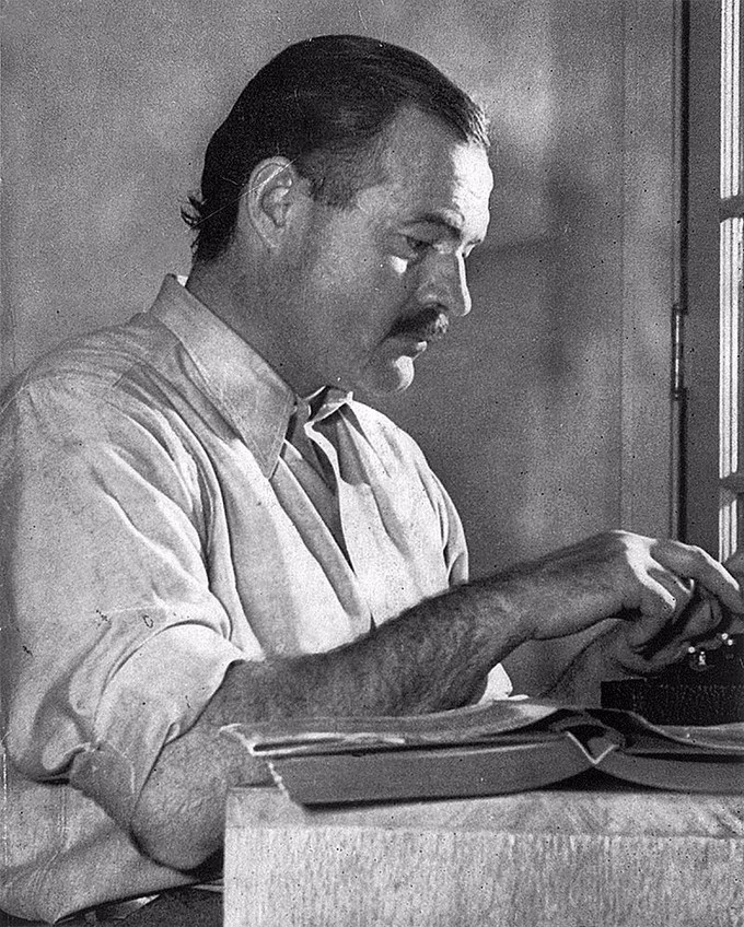 Photograph of Ernest Hemingway writing