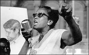 Photograph of Ella Baker speaking into a microphone