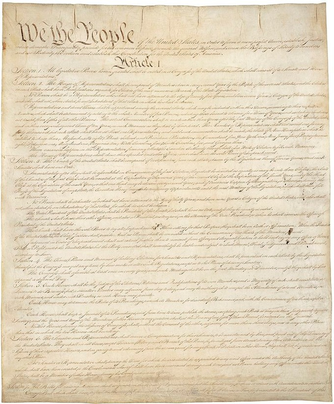 "This image shows the text of the US Constitution, though only the first three words, ""We the People,"" can be discerned."