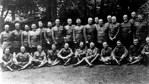 A photograph of about thirty uniformed men.