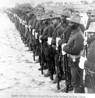 "The photo shows a line up of hundreds of soldiers. The caption of the photograph says ""Some of our brave Boys who helped to free Cuba."""