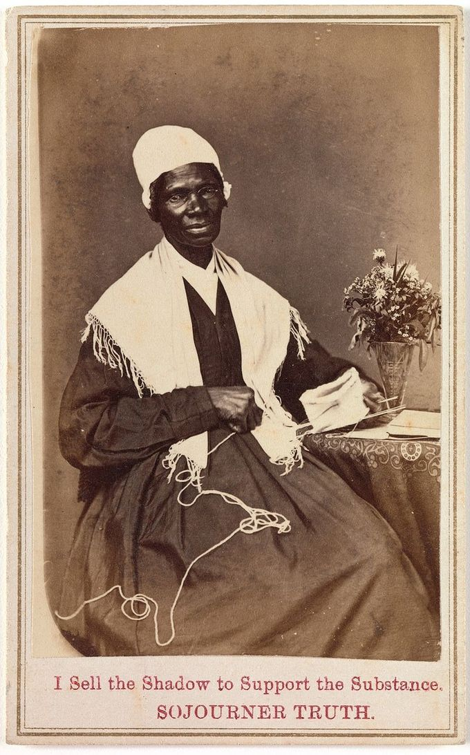 "The carte to visite shows Sojourner Truth knitting, sitting next to a small table with a vase of flowers. The inscription at the bottom of the card says ""I Sell the Shadow to Support the Substance. SOJOURNER TRUTH."""
