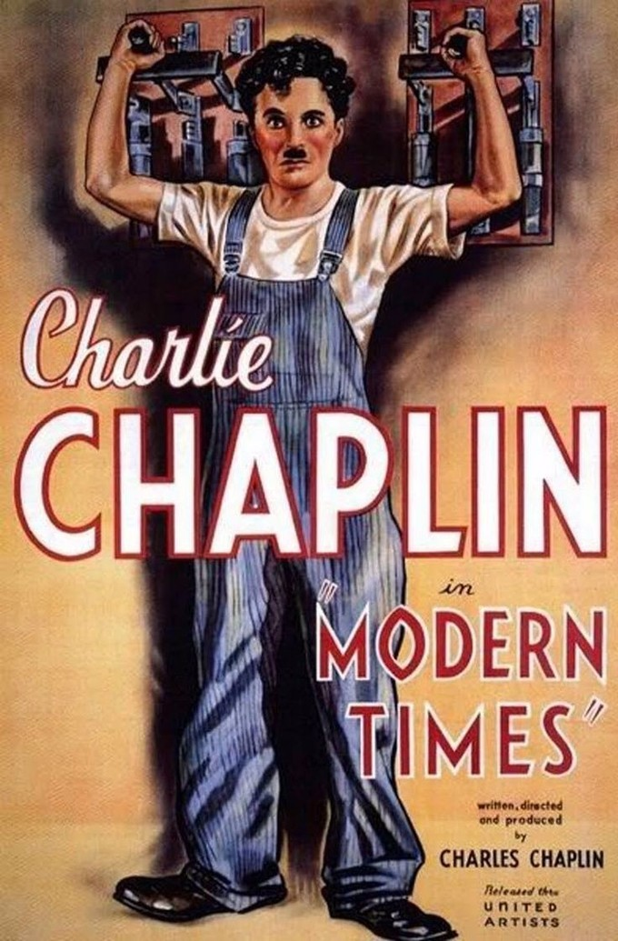 "The illustration on the poster depicts Charlie Chaplin, with his signature mustache, wearing blue overalls and a t-shirt. He has both hands reaching behind him. With each hand he grips the handle of a circuit breaker. The superimposed text on the poster reads, ""Charlie Chaplin in 'Modern Times' written, directed and produced by Charles Chaplin."""