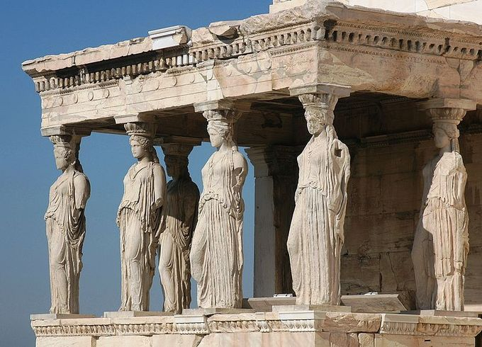 This image shows six caryatids. A caryatid is a sculpted female figure serving as an architectural support taking the place of a column or a pillar supporting an entablature on her head.