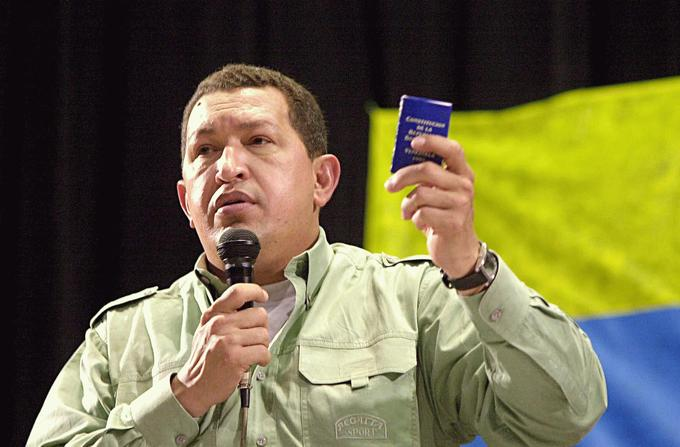 Chávez holds up a miniature copy of the 1999 Venezuelan Constitution at the 2005 World Social Forum held in Porto Alegre, Brazil.