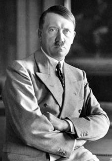 Photo of Adolph Hitler with his arms crossed.