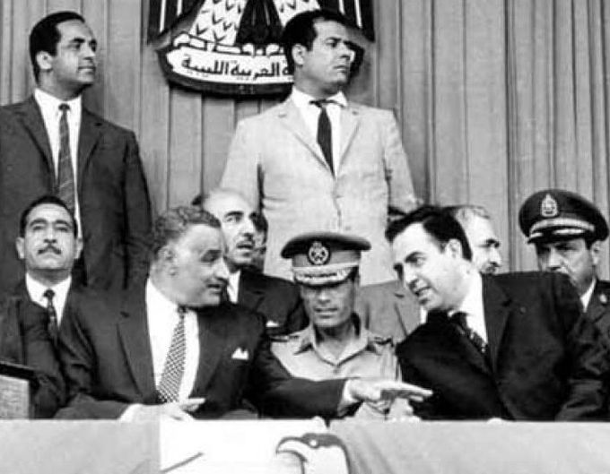 A photo of Muammar Gaddafi with Egyptian President Gamal Abdel Nasser to his left and Syrian President Nureddin al-Atassi to his right, shortly after the coup that brought him to power.
