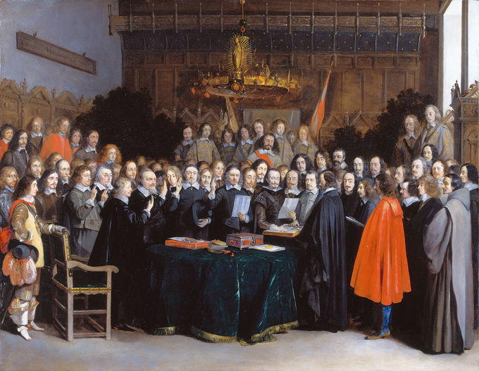 Painting of a large group of men overlooking a table containing the Treaty of Münster.