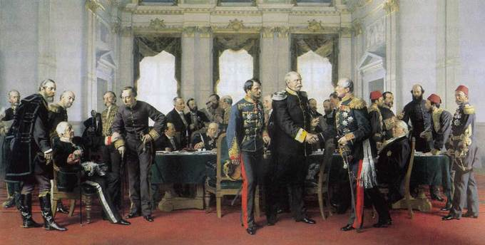 A painting of the Congress of Berlin, which depicts a few dozen men standing and sitting around a large table, some of them shaking hands.