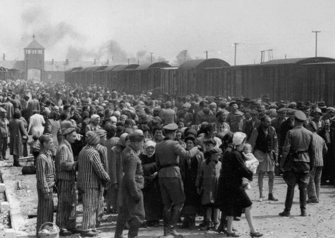 A large crowd of Jews coming off trains, being selected by German soldiers for the gas chambers at Auschwitz.
