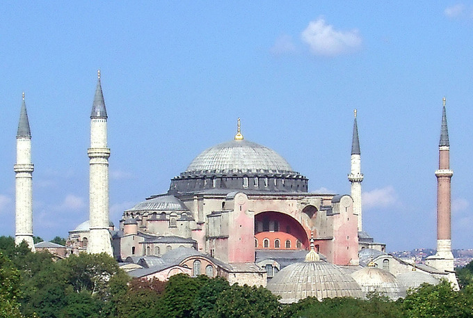 The Hagia Sophia is a massive basilica with four minarets (one in each corner of the building) and a large central dome.