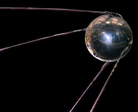 A photo of a replica of the Soviet satellite Sputnik, a silver orb which was the first satellite launched into space.