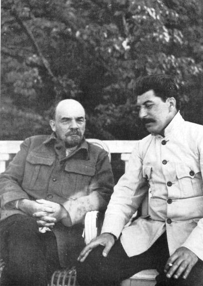 Photo of Lenin and Stalin seated outdoors.