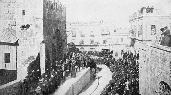 The formal transfer of Jerusalem to British rule. A native priest reads the proclamation from the steps of the Tower of David.