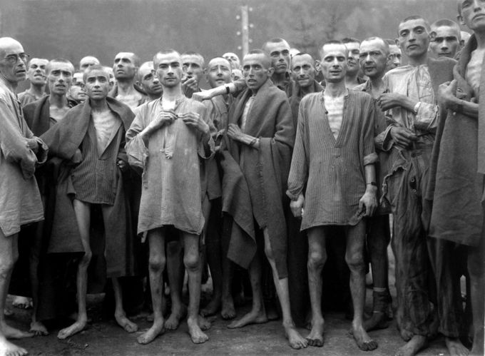 A photo of emaciated male prisoners recently liberated from a concentration camp.