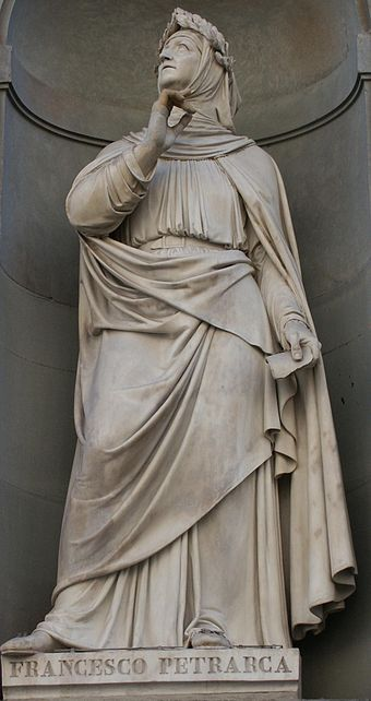A photo of a full-body statue of Petrarch.