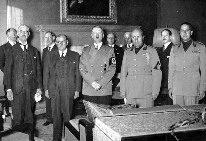 A photo of Chamberlain, Daladier, Hitler, Mussolini, and Ciano pictured before signing the Munich Agreement.