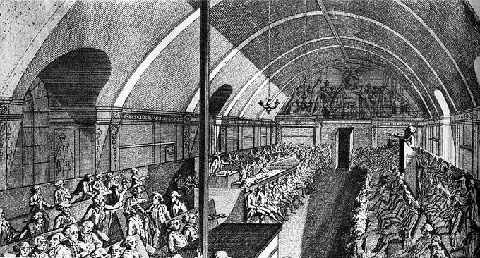 The illustration depicts a session at the Jacobin Club. Alexandre de Lameth presides while Mirabeau gives a speech.