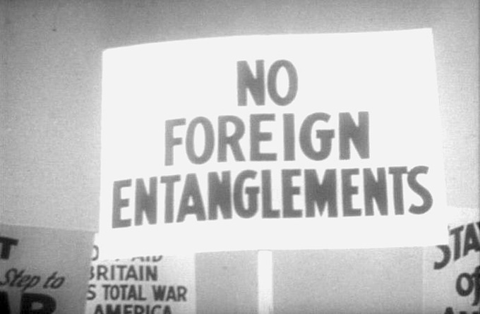 "A photo of a protester's sign reading ""No foreign entanglements."""
