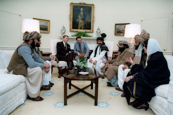 President Reagan meeting with Afghan Mujahideen leaders in the Oval Office in 1983
