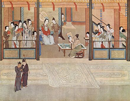 Painting of a Ming period palace, with women in luxurious clothing and makeup and a portrait painter.
