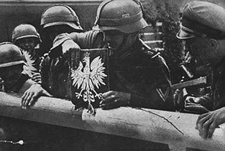 Photo of several German soldiers dismantling a border gate during the Invasion of Poland.