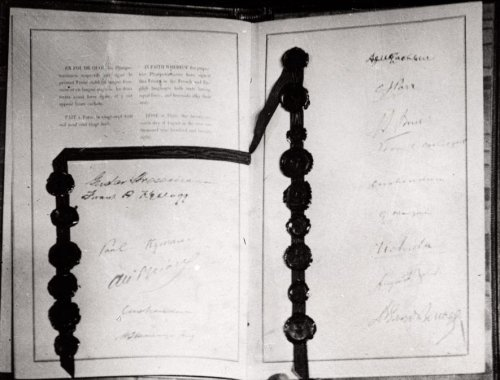 A photo of the actual signed Kellogg-Briand Pact (1928).