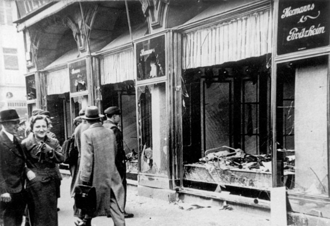 Photo of a storefront with the windows and signs destroyed.