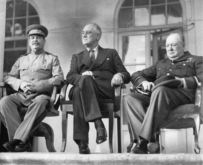 "A photo of the ""Big Three,"" Joseph Stalin, Franklin D. Roosevelt, and Winston Churchill, on the portico of the Russian Embassy during the Tehran Conference to discuss the European Theatre in 1943."