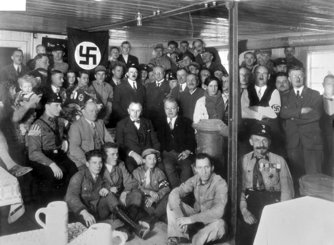 Hitler with a few dozen Nazi Party members in 1930.