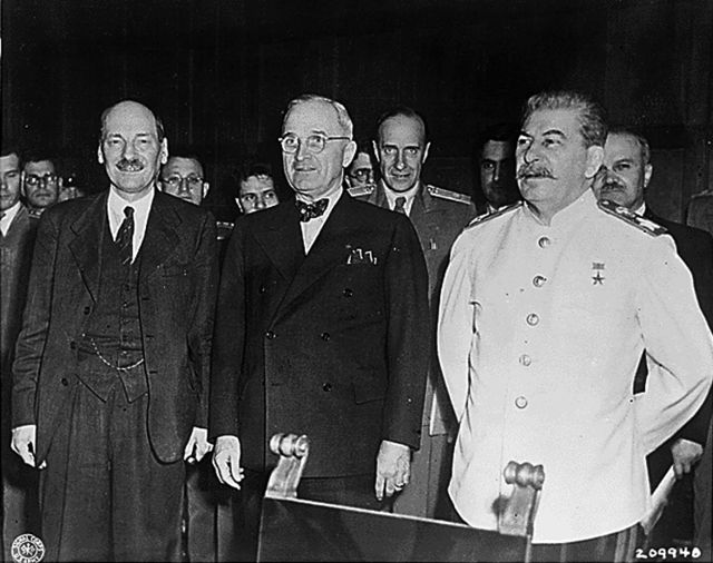 A photo of Joseph Stalin, Clement Attlee, Harry S. Truman at the Potsdam Conference.