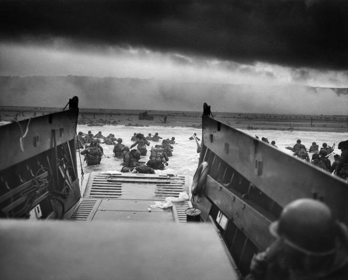 Photo from the U.S. Coast Guard-manned USS Samuel Chase showing soldiers disembarking on the Normandy shores.