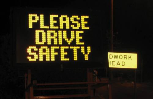 A sign that reads 'Please drive safety.'