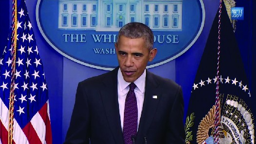 Photo shows President Obama giving a Press room briefing in the White House.