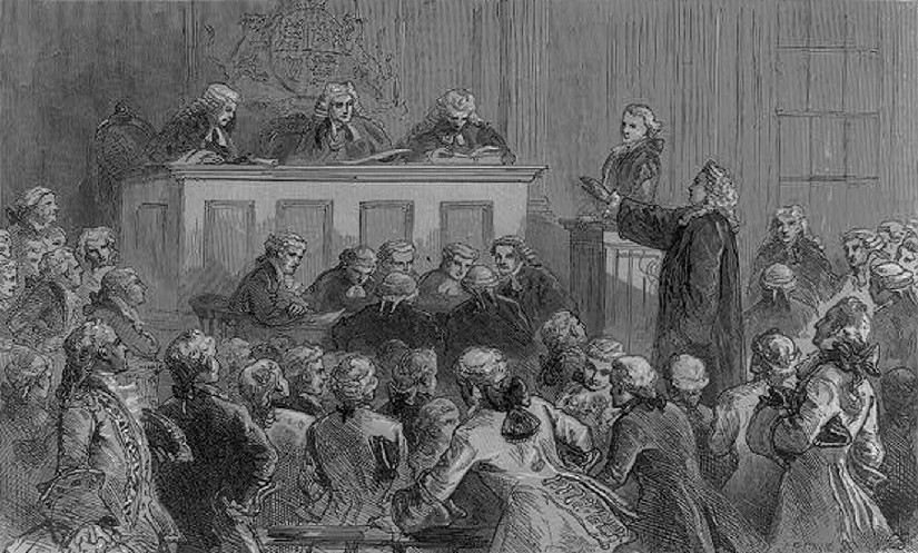An illustration of several men in a courtroom. One man is standing with his hand outstretched, facing the judge.