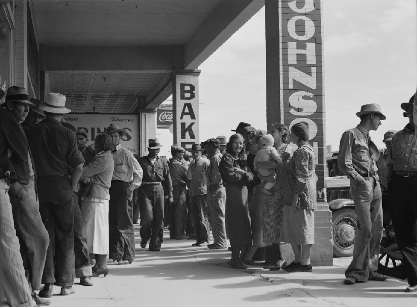 An image of people standing in long lines.