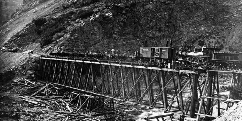 An image of the construction of a bridge for a railroad.