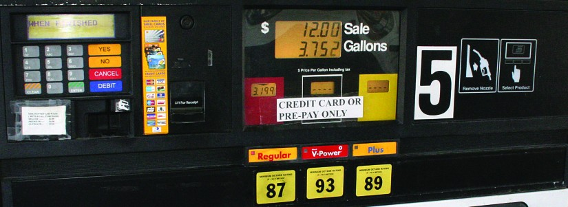 A gas pump that sold 3.752 gallons of gas for 12 dollars.