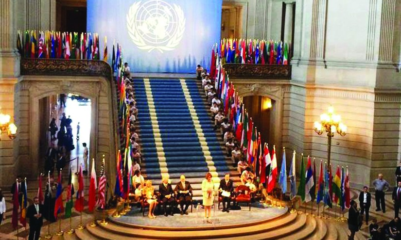 An image of Nancy Pelosi and several dignitaries at the United Nations Charter.