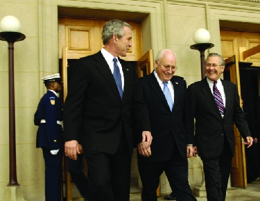 An image of Donald Rumsfeld, George W. Bush, and Dick Cheney walking together.